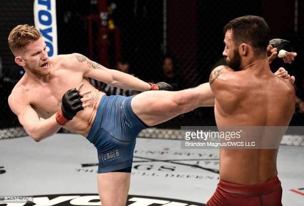 Austin Arnett kicks Brandon Davisin their featherweight bout during Dana White's Tuesday Night Contender Series at the TUF Gym on August 1 2017 in...
