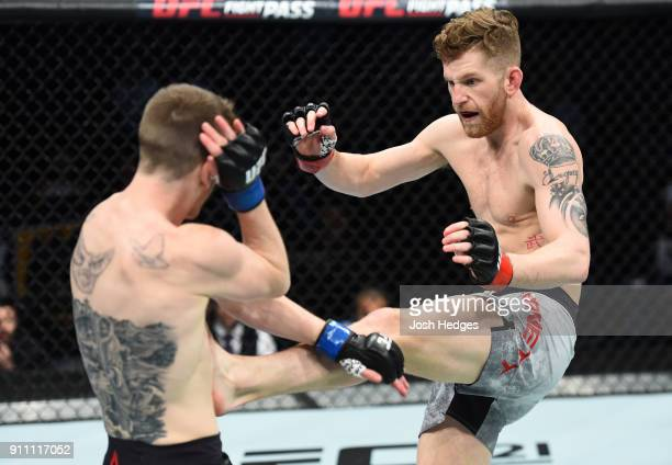 Austin Arnett kicks Cory Sandhagen in their featherweight bout during a UFC Fight Night event at Spectrum Center on January 27 2018 in Charlotte...