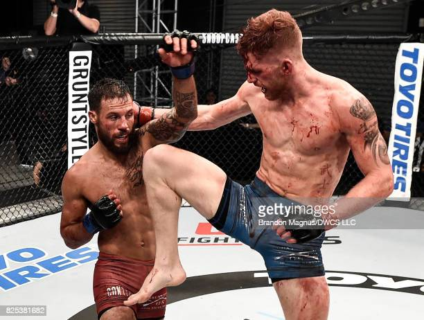 Austin Arnett knees Brandon Davis in their featherweight bout during Dana White's Tuesday Night Contender Series at the TUF Gym on August 1 2017 in...