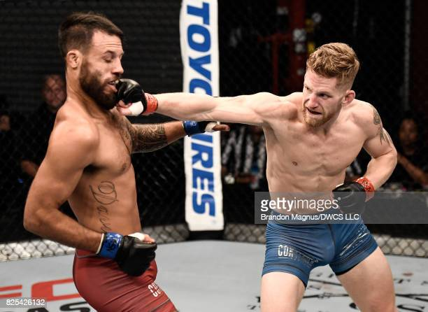 Austin Arnett punches Brandon Davis in their featherweight bout during Dana White's Tuesday Night Contender Series at the TUF Gym on August 1 2017 in...