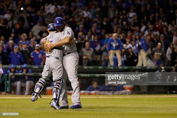 Austin Barnes and Kenley Jansen of the Los Angeles Dodgers celebrate after beating the Chicago Cubs 111 in game five of the National League...