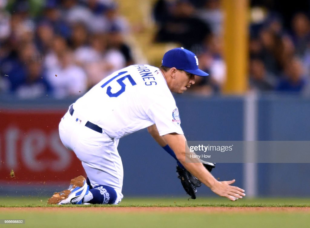 Austin Barnes #15 of the Los Angeles Dodgers can't make a play on a ball hit by Patrick Corbin #46 of the Arizona Diamondbacks for a single during the fourth inning at Dodger Stadium on May 9, 2018 in Los Angeles, California.