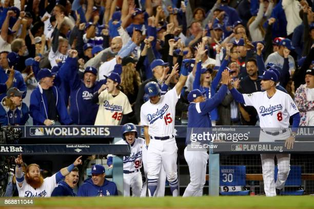 Austin Barnes of the Los Angeles Dodgers celebrates after Joc Pederson hit a solo home run during the seventh inning against the Houston Astros in...