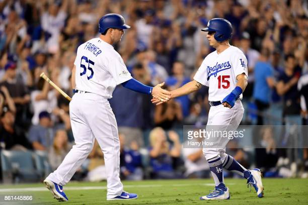 Austin Barnes of the Los Angeles Dodgers celebrates after scoring off of a sacfly hit by Charlie Culberson of the Los Angeles Dodgers against Jose...