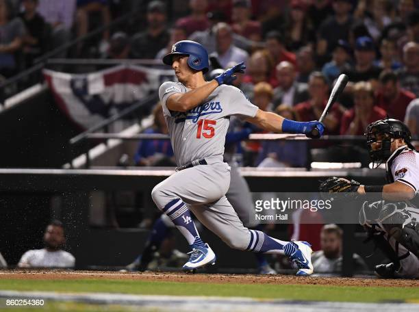 Austin Barnes of the Los Angeles Dodgers follows through on a swing during game three of the National League Divisional Series against the Arizona...