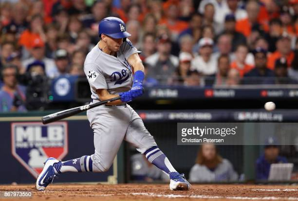 Austin Barnes of the Los Angeles Dodgers hits a RBI single during the fourth inning against the Houston Astros in game five of the 2017 World Series...