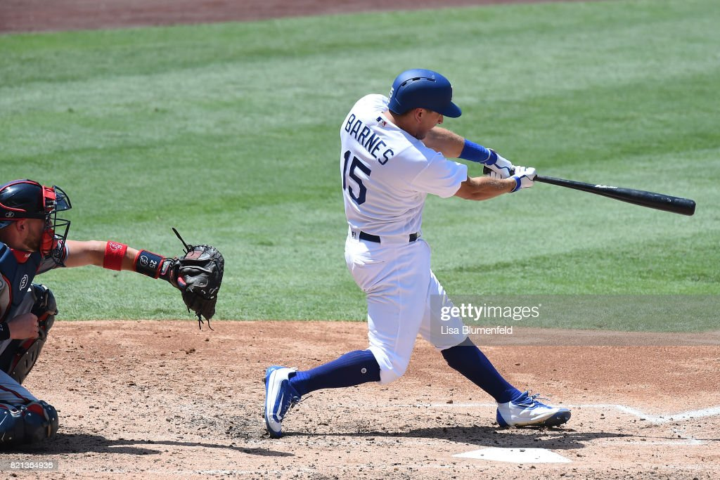 Austin Barnes #15 of the Los Angeles Dodgers hits a three run homerun in the fourth inning against the Atlanta Braves at Dodger Stadium on July 23, 2017 in Los Angeles, California.