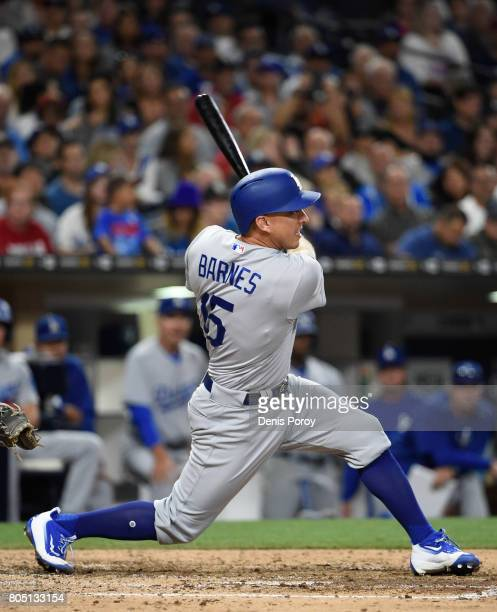 Austin Barnes of the Los Angeles Dodgers hits a threerun home run during the sixth inning of a baseball game against the San Diego Padres at PETCO...
