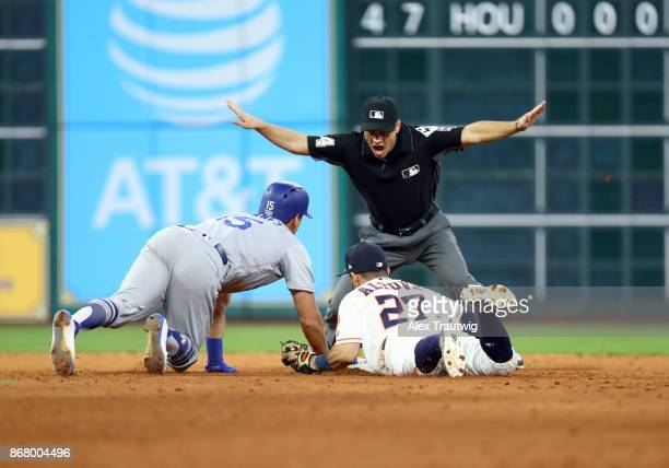 Austin Barnes of the Los Angeles Dodgers is safe at second as he slides ahead of the tag by Jose Altuve of the Houston Astros in the ninth inning of...