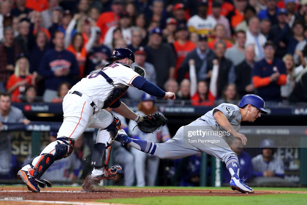 Austin Barnes #15 of the Los Angeles Dodgers is tagged out trying to score by Brian McCann #16 of the Houston Astros during the sixth inning in game four of the 2017 World Series at Minute Maid Park on October 28, 2017 in Houston, Texas.