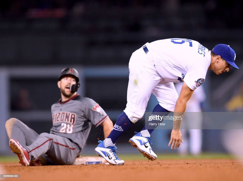 Austin Barnes #15 of the Los Angeles Dodgers loses his balance as Steven Souza Jr. #28 of the Arizona Diamondbacks slides into a force out at second base to end the top of the seventh inning at Dodger Stadium on May 9, 2018 in Los Angeles, California.