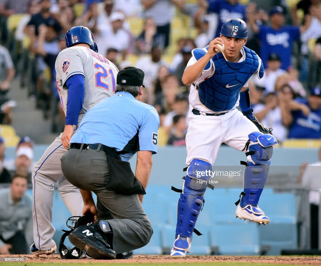 Austin Barnes #15 of the Los Angeles Dodgers reacts after tagging out Lucas Duda #21 of the New York Mets at home during the second inning at Dodger Stadium on June 22, 2017 in Los Angeles, California.