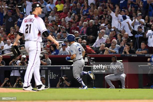 Austin Barnes of the Los Angeles Dodgers rounds the bases after hitting a solo home run in the sixth inning of game three of the National League...