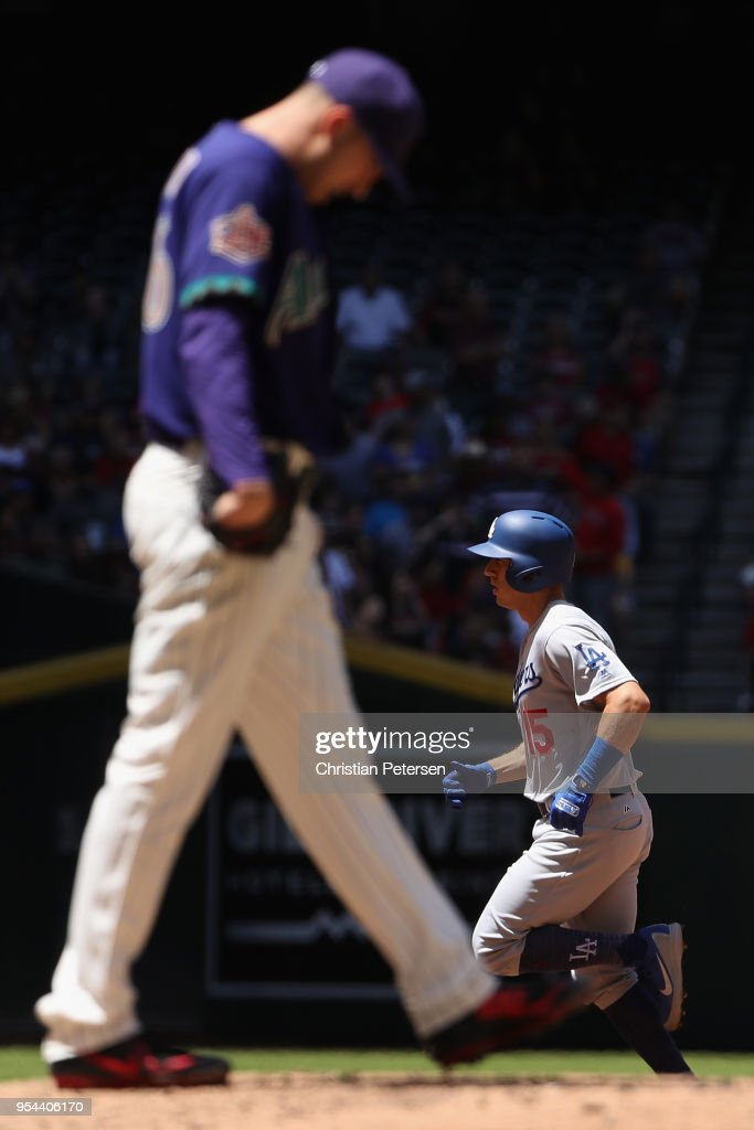 Austin Barnes #15 of the Los Angeles Dodgers rounds the bases after hitting a solo home run off starting pitcher Patrick Corbin #46 of the Arizona Diamondbacks during the second inning of the MLB game at Chase Field on May 3, 2018 in Phoenix, Arizona. The Dodgers defeated the Diamondbacks 5-2.