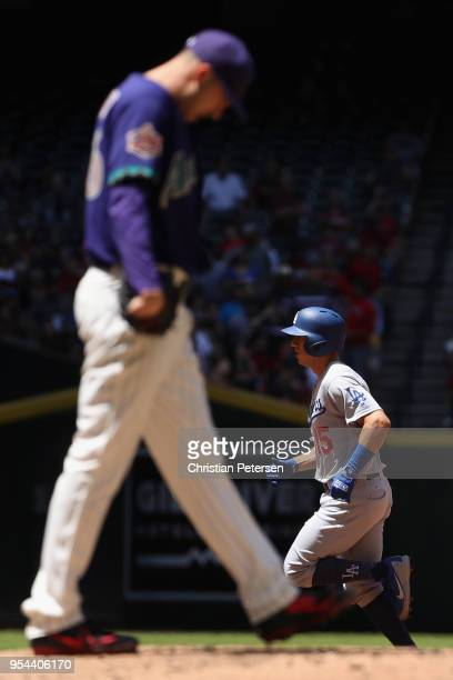 Austin Barnes of the Los Angeles Dodgers rounds the bases after hitting a solo home run off starting pitcher Patrick Corbin of the Arizona...