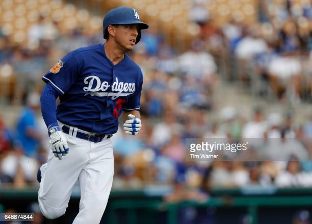 Austin Barnes of the Los Angeles Dodgers runs out a fly ball in the second inning against the Seattle Mariners during the spring training game at...