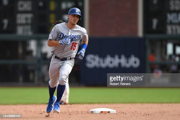 Austin Barnes of the Los Angeles Dodgers runs the bases after a homerun against the San Francisco Giants during their MLB game at ATT Park on...