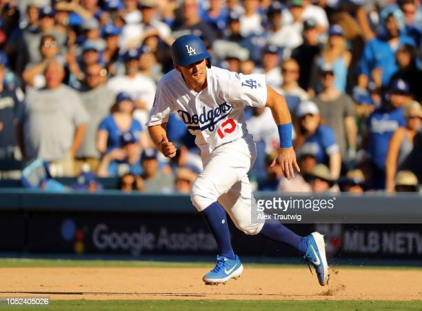 Austin Barnes of the Los Angeles Dodgers runs to second in the fifth inning of Game 5 of the NLCS against the Milwaukee Brewers at Dodger Stadium on...