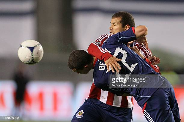 Austin Berry of the Chicago Fire heads the ball clear from Alejandro Moreno of Chivas USA in the second half of the MLS match at The Home Depot...