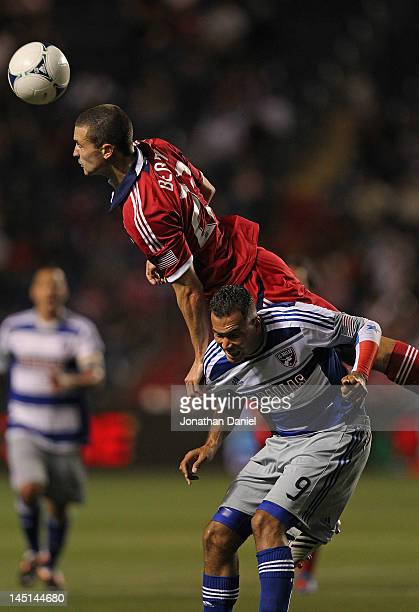 Austin Berry of the Chicago Fire heads the ball over Blas Perez of FC Dallas during an MLS match at Toyota Park on May 23 2012 in Bridgeview Illinois...