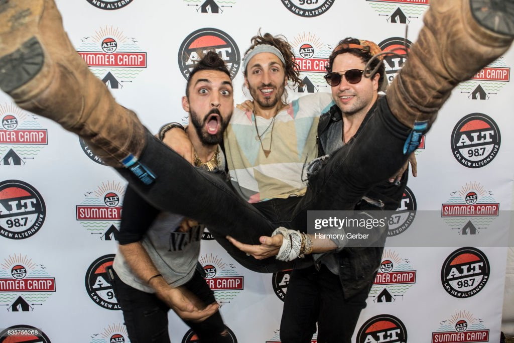 Austin Bisnow, Zambricki Li and Brian Zaghi of Magic Giant pose backstage at Alt 98.7 Summer Camp at Queen Mary Events Park on August 19, 2017 in Long Beach, California.