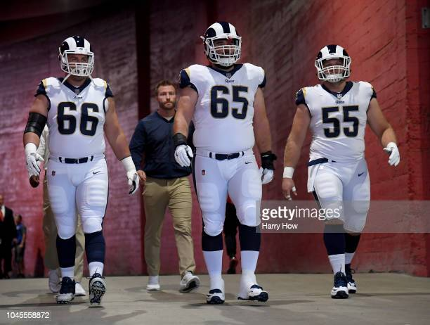 Austin Blythe John Sullivan and Brian Allen of the Los Angeles Rams head to the field before the game against the Arizona Cardinalsat Los Angeles...