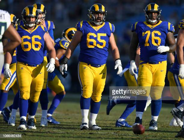 Austin Blythe John Sullivan and Rodger Saffold of the Los Angeles Rams at Los Angeles Memorial Coliseum on November 11 2018 in Los Angeles California...