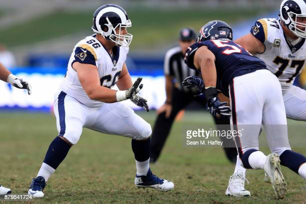 Austin Blythe of the Los Angeles Rams blocks during the first half of game against the Houston Texans at Los Angeles Memorial Coliseum on November 12...