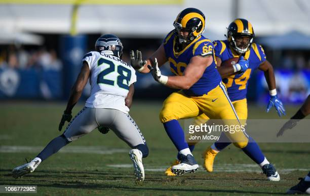 Austin Blythe of the Los Angeles Rams blocks Justin Coleman of the Seattle Seahawks to allow Malcolm Brown room to run at Los Angeles Memorial...