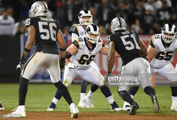 Austin Blythe of the Los Angeles Rams pass protect against the Oakland Raiders during the fourth quarter of an NFL football game at OaklandAlameda...