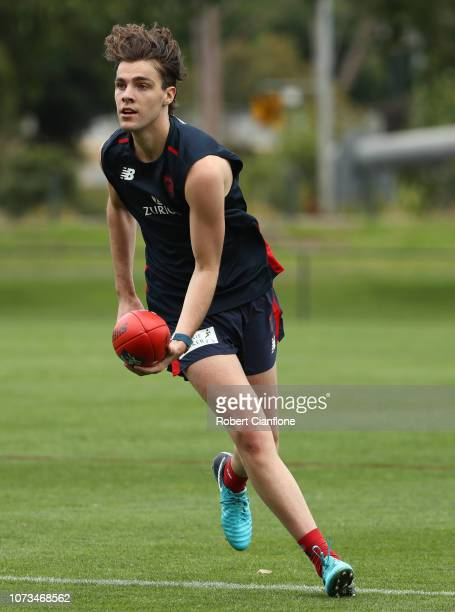 Austin Bradtke of the Demons runs with the ball during a Melbourne Demons AFL training session at Gosch's Paddock on November 28 2018 in Melbourne...