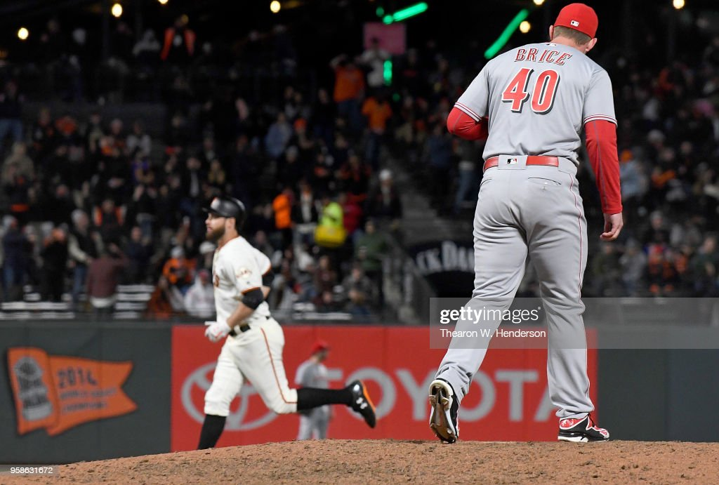 Austin Brice #40 of the Cincinnati Reds looks on as Brandon Belt #9 of the San Francisco Giants trots around the bases after Belt hit a solo home run off of Brice in the bottom of the eighth inning at AT&T Park on May 14, 2018 in San Francisco, California. The Giants won the game 10-7.