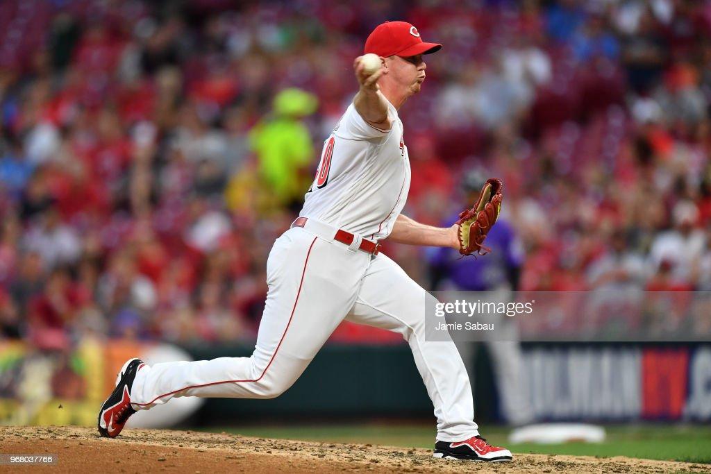 Austin Brice #40 of the Cincinnati Reds pitches in the sixth inning against the Colorado Rockies at Great American Ball Park on June 5, 2018 in Cincinnati, Ohio. Colorado defeated Cincinnati 9-6.