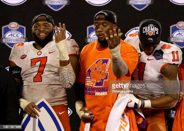 Austin Bryant and teammates Clelin Ferrell and Isaiah Simmons of the Clemson Tigers signal four ACC Championships in a row after their 4210 victory...