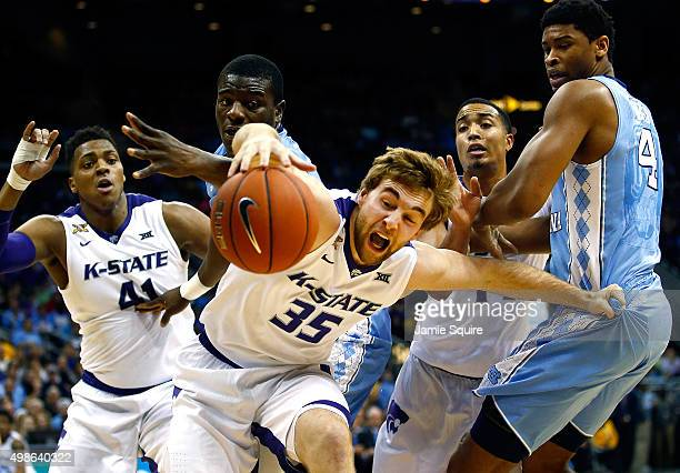 Austin Budke of the Kansas State Wildcats lunges for a loose ball during the CBE Hall Of Fame Classic game against the North Carolina Tar Heels at...