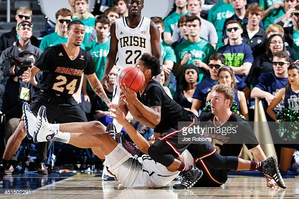 Austin Burgett of the Notre Dame Fighting Irish battles for a loose ball against Brandon Clark of the Santa Clara Broncos during the first half of...