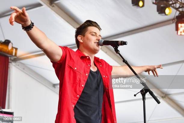 Jess Carson Mark Wystrach and Cameron Duddy of the band Midland perform at Michigan International Speedway on July 20 2018 in Brooklyn Michigan