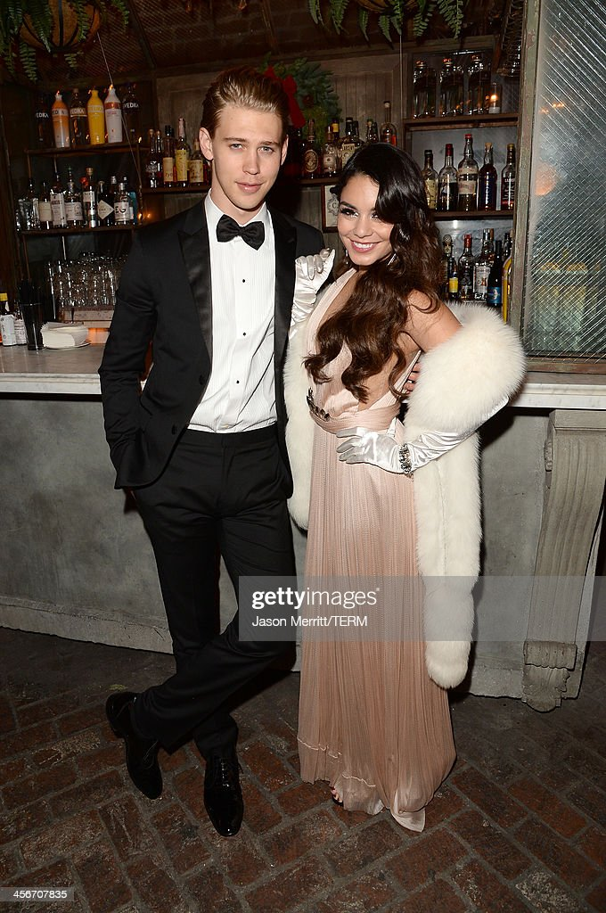 Austin Butler (L) and Vanessa Hudgens attend her birthday party held at No Vacancy on December 14, 2013 in Hollywood, California.