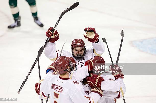 Austin Cangelosi of the Boston College Eagles celebrates his goal with his teammates Destry Straight , Michael Matheson, Ryan Fitzgerald and Teddy...