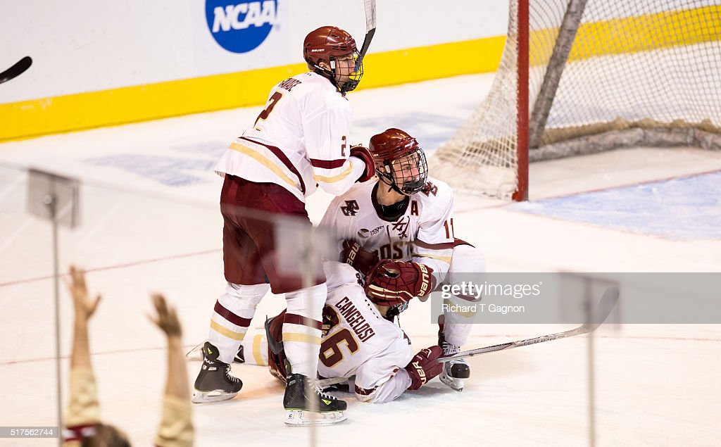 Austin Cangelosi #26 of the Boston College Eagles celebrates his second goal of the game against the Harvard Crimson with teammates Chris Calnan #11 and Scott Savage #2 during game two of the NCAA Division I Men's Ice Hockey Northeast Regional Championship Semifinals at the DCU Center on March 25, 2016 in Worcester, Massachusetts. The Eagles won 4-1.