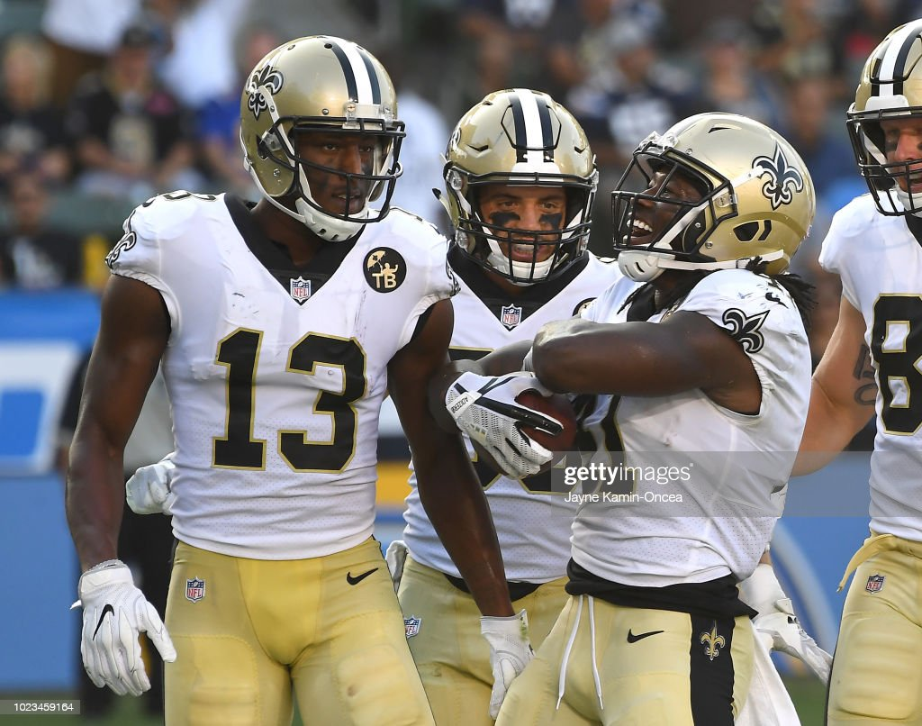Austin Carr #80 and Michael Thomas #13 celebrate after a touchdown by Alvin Kamara #41 of the New Orleans Saints in the second quarter of the pre-season game against the Los Angeles Chargers at StubHub Center on August 25, 2018 in Carson, California.