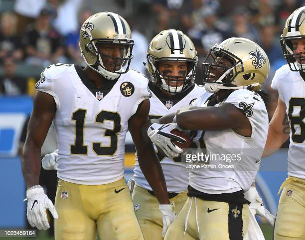 Austin Carr and Michael Thomas celebrate after a touchdown by Alvin Kamara of the New Orleans Saints in the second quarter of the preseason game...