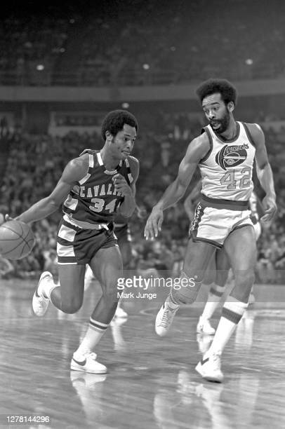 Austin Carr of the Cleveland Cavaliers drives past Willie Wise during a game against the Denver Nuggets at McNichols Arena on December 9 1976 in...