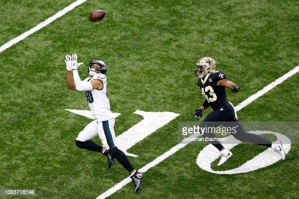 Austin Carr of the New Orleans Saints makes a first quarter touchdown reception past Darren Sproles of the Philadelphia Eagles in the NFC Divisional...