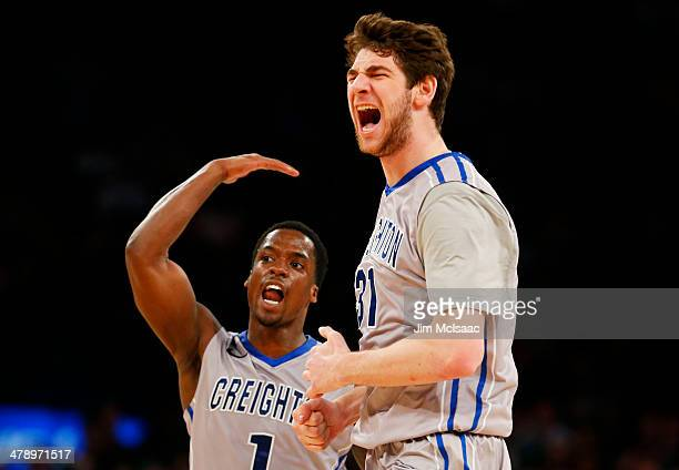 Austin Chatman and Will Artino of the Creighton Bluejays react in the first half against the Providence Friars during the Championship game of the...