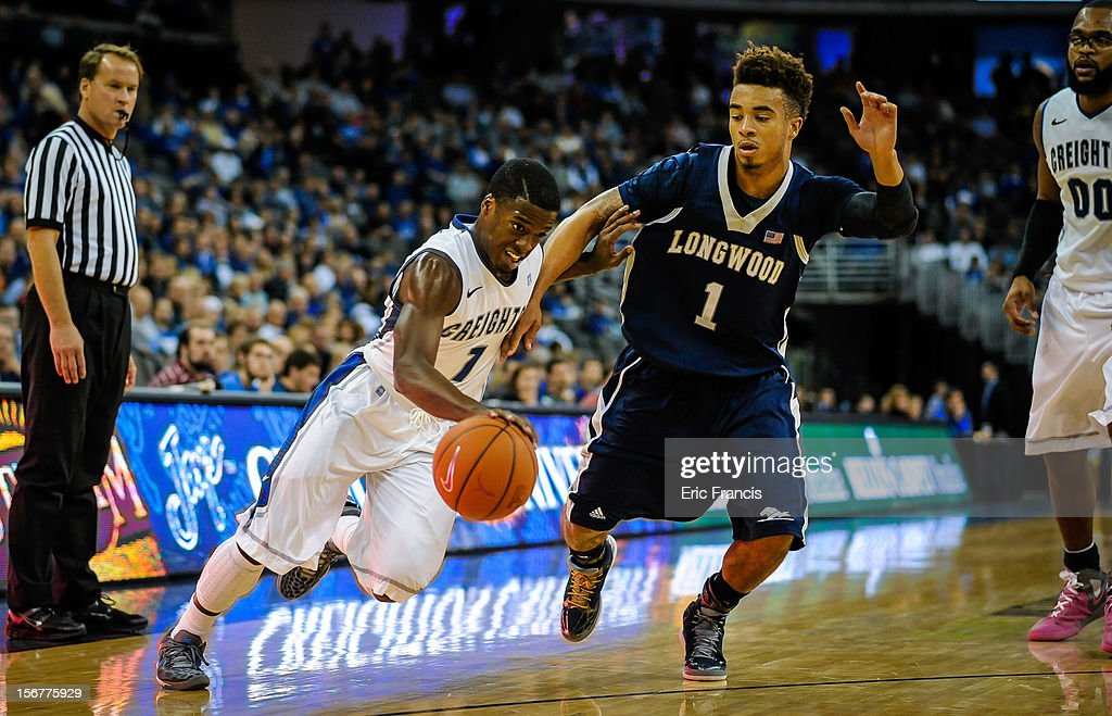 Austin Chatman #1 of the Creighton Bluejays drives around Nik Brown #1 of the Longwood Lancers during their game at CenturyLink Center on November 20, 2012 in Omaha, Nebraska.