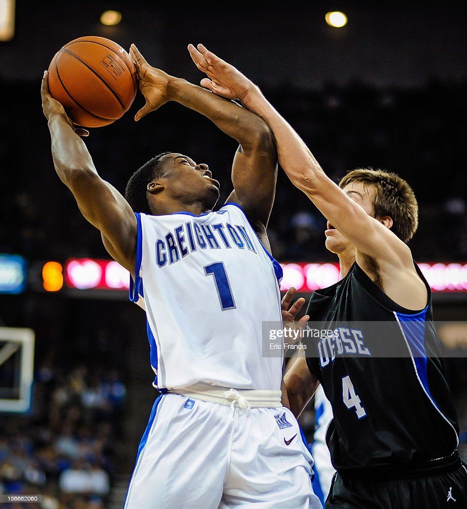 Austin Chatman #1 of the Creighton Bluejays drives to the basket against Austin Anderson #4 of the Presbyterian Blue Hose during their game at CenturyLink Center on November 18, 2012 in Omaha, Nebraska.