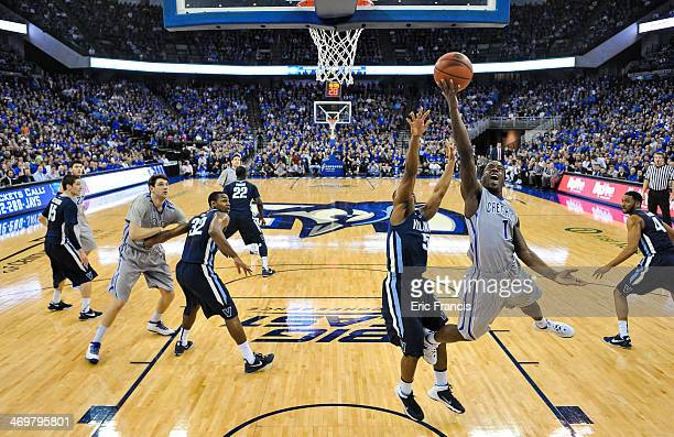 Austin Chatman of the Creighton Bluejays drives to the basket past Tony Chennault of the Villanova Wildcats during their game at CenturyLink Center...