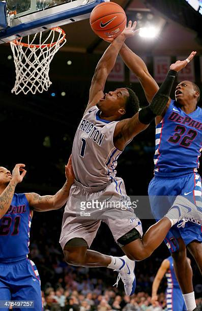 Austin Chatman of the Creighton Bluejays is fouled by Charles McKinney of the DePaul Blue Demons during the quarterfinals of the Big East Basketball...