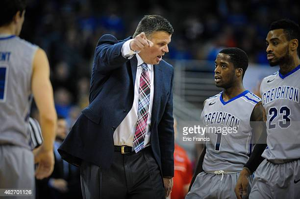 Austin Chatman of the Creighton Bluejays listens to head coach Greg McDermott of the Creighton Bluejays during their game against the St John's Red...